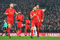 Liverpool's James Milner celebrates scoring his side's second goal from the penalty spot during the Premier League match at Anfield, Liverpool.