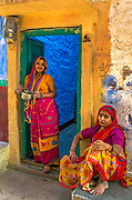 Two local ladies in a doorway, Jodhpur.The Blue City was historically the capital of the Kingdom of Marwar, now part of Rajasthan. It is the most important city of Rajasthan after the capital Jaipur, central to the Thar desert region and its colourful culture.