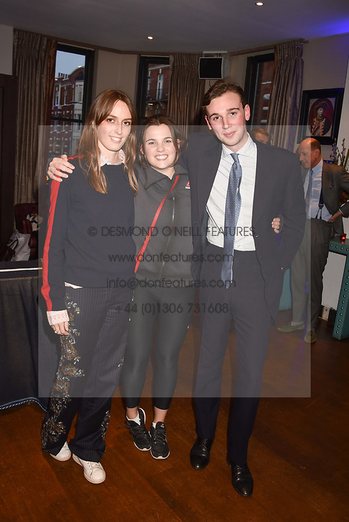 Left to right, Lady Alice Manners, Katie Watkins and Tom Mundy at The Tribe Syndicate launch party hosted by Highclere Thoroughbred Racing at Beaufort House, 354 King's Rd, London England. 25 April 2018.