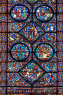 Medieval stained glass Window of the Gothic Cathedral of Chartres, France - dedicated to the life of St Anthony of the Desert. .<br /> <br /> Visit our MEDIEVAL ART PHOTO COLLECTIONS for more   photos  to download or buy as prints https://funkystock.photoshelter.com/gallery-collection/Medieval-Middle-Ages-Art-Artefacts-Antiquities-Pictures-Images-of/C0000YpKXiAHnG2k