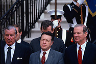Washington, DC 1985/03/12  Donald Regan, Casper Weinberger,and James Baker, Regan's top advisors at a departure ceremony at the dipolomatic entrance of the White House,<br /> <br /> Photograph by Dennis Brack
