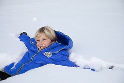 boy enjoying time playing in snow