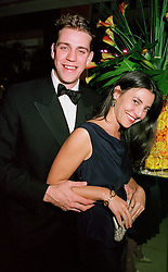 MR BEN ELLIOT, nephew of Camilla Parker Bowles and MISS ATHENA MALPAS, at a party in London on 17th October 2000.OHY 137