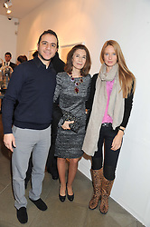 Left to right, NADER HARB, AMALE HARB and DARYA HARB at a private view of jewellery by Eugenie Nairchos and Noor Fares entitled Galactic Garden held at Shizaru Mayfair, 112 Mount Street, London on 5th December 2012.