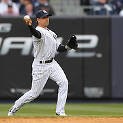 Brian Roberts, New York Yankees, fielding at second base during the New York Yankees V Baltimore Orioles home opening day at Yankee Stadium, The Bronx, New York. 7th April 2014. Photo Tim Clayton