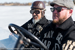 Max Hermann and Sushi in Max's hotrod out on the ice at Lake Sinissippi on an unseasonably warm day after the Mama Tried Bike Show. Milwaukee, WI, USA. Sunday February 19, 2017. Photography ©2017 Michael Lichter.