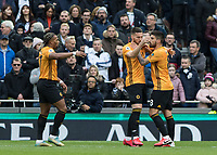 Football - 2019 / 2020 Premier League - Tottenham Hotspur vs. Wolverhampton Wanderers<br /> <br /> Wolves players congratulate Matt Doherty (Wolverhampton Wanderers) after he scores at The Tottenham Hotspur Stadium.<br /> <br /> COLORSPORT/DANIEL BEARHAM