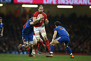 Alun Wyn Jones, the Wales captain © bursts through a gap in the French defence.  Wales v France, NatWest 6 nations 2018 championship match at the Principality Stadium in Cardiff , South Wales on Saturday 17th March 2018.<br /> pic by Andrew Orchard, Andrew Orchard sports photography