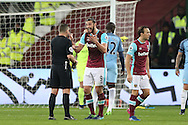 Andy Carroll of West Ham United reacts as he argues and gets frustrated with Referee Kevin Friend. Premier league match, West Ham Utd v Manchester city at the London Stadium, Queen Elizabeth Olympic Park in London on Wednesday 1st February 2017.<br /> pic by John Patrick Fletcher, Andrew Orchard sports photography.