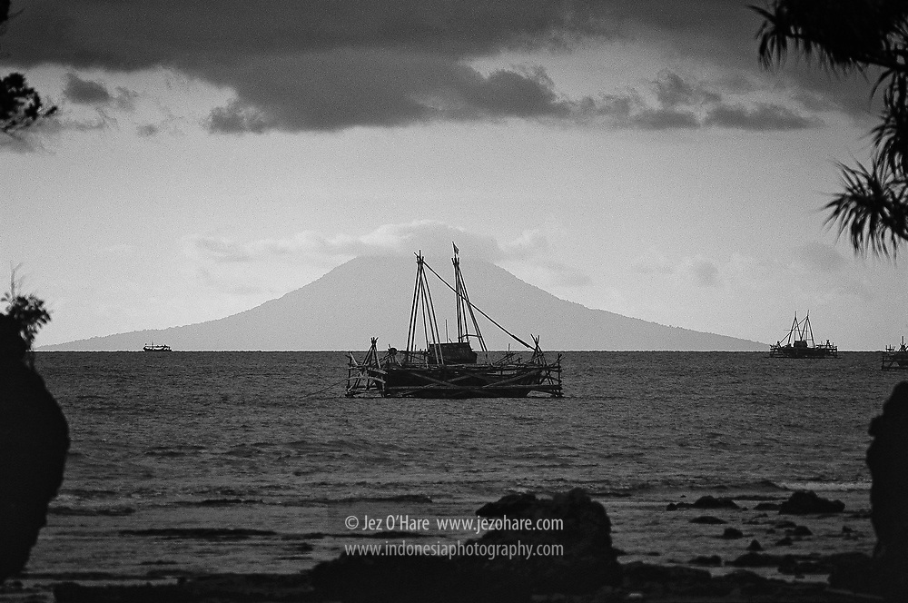Fishing Platform with Mount Rakata in the background, Tanjung Lesung Area, Sunda Straits, Pandeglang, Banten, Java, Indonesia.