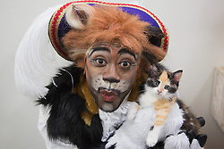 "© Licensed to London News Pictures. 23/10/2013. London, England. Picture: KAT B with stray kitten Thumper, 6 weeks. Actor KAT B visits the cattery of Battersea Dogs & Cats before starring in the title role of the ""Puss in Boots"" Christmas Panto at the Hackney Empire, London. Hackney Empire and the Battersea Dogs & Cats Home have teamed up to find homes for rescue moggies which will be featured in the pantomime programme. Photo credit: Bettina Strenske/LNP"