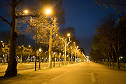 """March, 19th, 2020 - Paris, Ile-de-France, France: Empty Avenue des Champs Elysees in Paris, on the third day of a near total lockdown imposed in France. All journeys outside the home unless justified for essential professional or health reasons are outlawed. Anyone flouting the new regulations is punished with monetary fines. French police control of citizens and inspection of valid papers allowing citizens to travel. The most extreme measures so far in France to control the spread of the Coronavirus. Earlier in the week, President of France, Emmanuel Macron, said that citizens must stay at home from midday on Tuesday for at least 15 days. He said """"We are at war, a public health war, certainly but we are at war, against an invisible and elusive enemy"""". Nigel Dickinson"""
