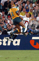 Photo: Richard Lane.<br />Australia v England. Rugby World Cup Final, at the Telstra Stadium, Sydney. RWC 2003. 22/11/2003. <br />Lote Tuqiri beats Jason Robinson to the ball for an early try.