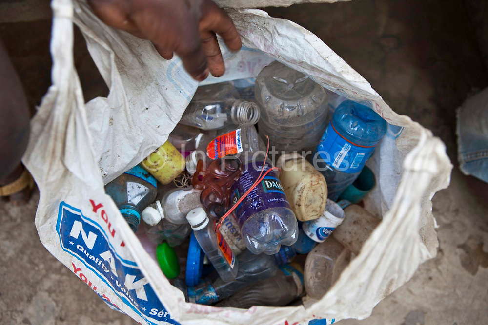 Plastic bottles have been collected by the street kids of the Dandora slum to sell to the recycling dealers. Undugu Society of Kenya (USK), an NGO who run various programmes in the area and at local schools.