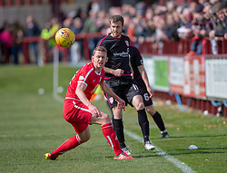 Brechin City's Scott Robertson and Arbroath's Danny Denholm. Brechin City 1 v 1 Arbroath, Scottish Football League Division One played 13/4/2019 at Brechin City's home ground Glebe Park. Arbroath win promotion.
