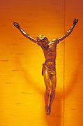 Crucified Jesus on luminous orange wall