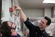 "Dessert chef Johnny Iuzzini feeds a freind a sample of rhubarb ""spaghetti."""