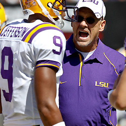 Oct 2, 2010; Baton Rouge, LA, USA; LSU Tigers offensive coordinator Gary Crowton talks with quarterback Jordan Jefferson (9) prior to kickoff of a game between the LSU Tigers and the Tennessee Volunteers at Tiger Stadium.  Mandatory Credit: Derick E. Hingle