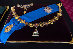 The Garter Collar and Greater George, and the Garter Breast Star and Lesser George sewn onto a cushion in St James's Palace, London. The cushions displaying medals and decorations conferred on the Duke of Edinburgh by the United Kingdom and other countries across the world, together with his Field Marshal's baton and Royal Air Force Wings, and insignia from Denmark and Greece, will be placed on the altar in St George's Chapel, in Windsor, ahead of his funeral on Saturday. Picture date: Tuesday April 13, 2021.