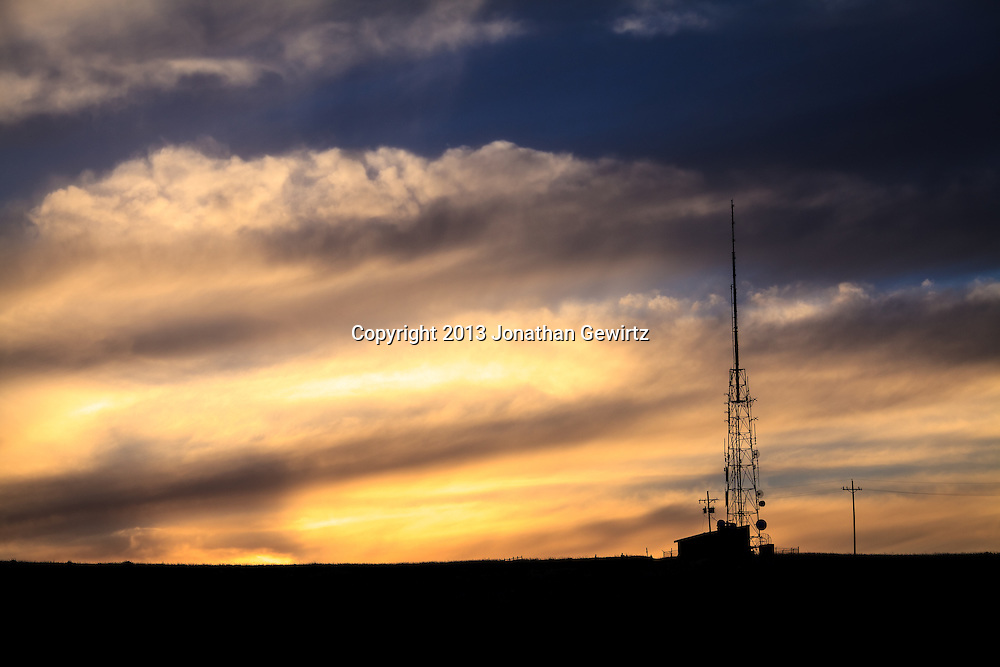 A radio antenna silhouetted against the western sky around sunset in the William F. Hayden Park on Green Mountain in Lakewood, Colorado.<br /> <br /> WATERMARKS WILL NOT APPEAR ON PRINTS OR LICENSED IMAGES.