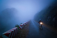 Single motorbike drives along a section of Ma Pi Leng pass between Dong Van and Meo Vac in Ha Giang Province, Vietnam, Southeast Asia