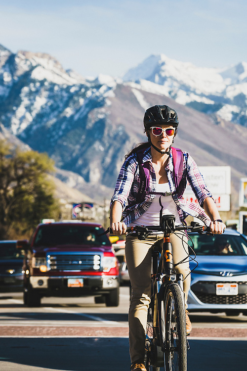 Rush hour. Amanda Cordell cruises through downtown Holladay on a spring afternoon, Utah.