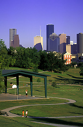 Stock photo of the Houston skyline featuring Spotts Park in the foreground