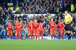 Liverpool's Luis Suarez gestures towards the Everton fans after celebrating his goal - Photo mandatory by-line: Dougie Allward/JMP - Tel: Mobile: 07966 386802 23/11/2013 - SPORT - Football - Liverpool - Merseyside derby - Goodison Park - Everton v Liverpool - Barclays Premier League