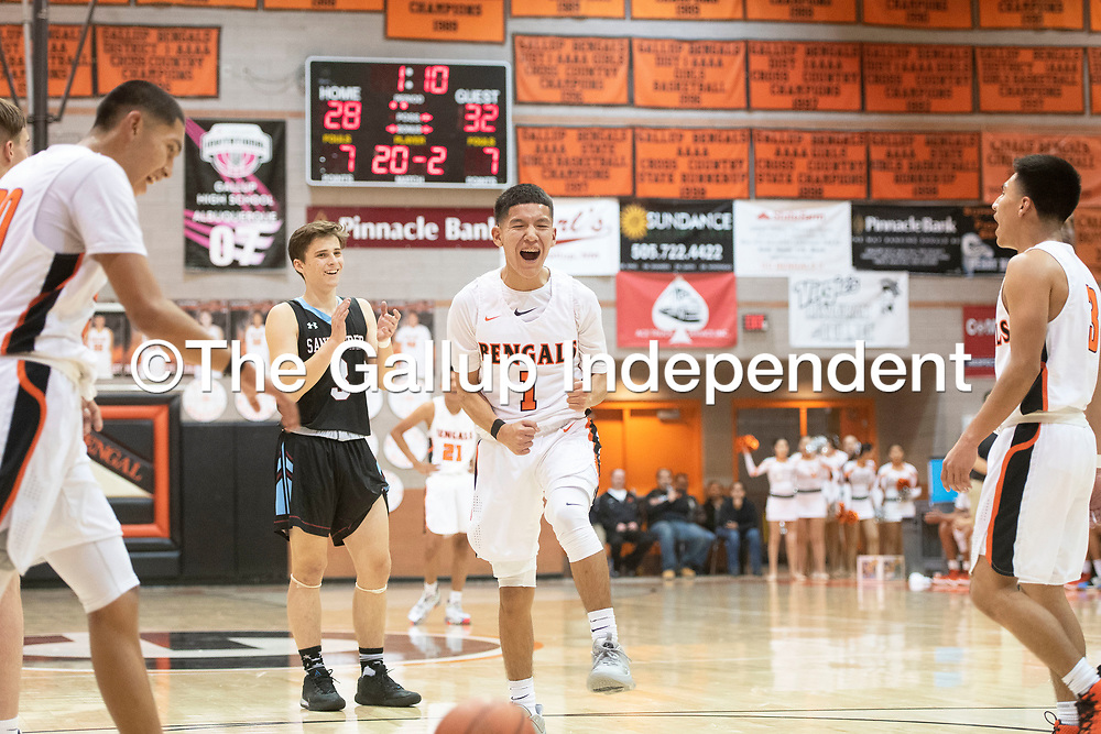 Gallup's Quentin Richards (1) reacts to missing a free throw in the second quarter against Sandia Prep Friday night at the Gallup Invitational boys basketball tournament at Gallup High School. Gallup beat Sandia Prep 61-60.