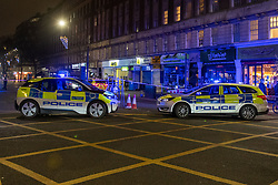 © Licensed to London News Pictures. 01/01/2021. London, UK. Police vehicles at a cordon on Edgeware Road. Metropolitan police were contacted by London Fire Brigade at 00:32GMT on Friday 01/01/2021 to reports of a stabbing on Edgware Road.  Police officers attended the scene along with the London Ambulance Service and an advanced trauma team car from London's Air Ambulance. Two males were identified with stab injuries and taken to a major trauma centre. A women was also located at the scene suffering with a head injury, she has been taken to hospital. Photo credit: Peter Manning/LNP