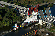 Space Shuttle Inspiration, a full scale shuttle model, gets moved for the Astronaut Hall Of Fame down a road, onto a barge, and down the Indian River on its way to a ship yard to be refurbished in Titusville, FL on Saturday, January 16th, 2016.