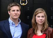 © Licensed to London News Pictures. 15/04/2013. London, UK Michael Thatcher and Amanda Thatcher pose on the steps of Baroness Thatcher's former home in London. Photo credit : Stephen Simpson/LNP