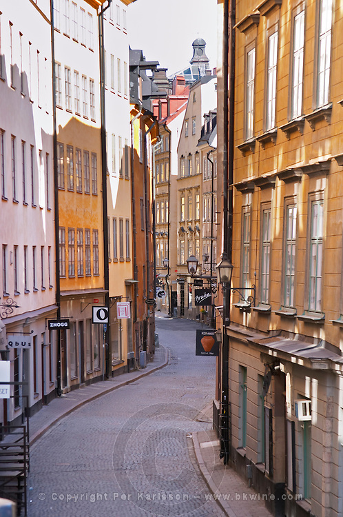 A narrow winding street, Osterlanggatan, The East Long Street, in the Old Town, Gamla Stan. Stockholm. Sweden, Europe.