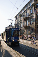 number 75 blue tram on linia czasowa to bronowice arrives in krakow old town on sunny afternoon in september 2005