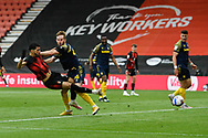 Dominic Solanke (9) of AFC Bournemouth is challenged by Adam Davies (16) of Stoke City as he shoots at goal during the EFL Sky Bet Championship match between Bournemouth and Stoke City at the Vitality Stadium, Bournemouth, England on 8 May 2021.