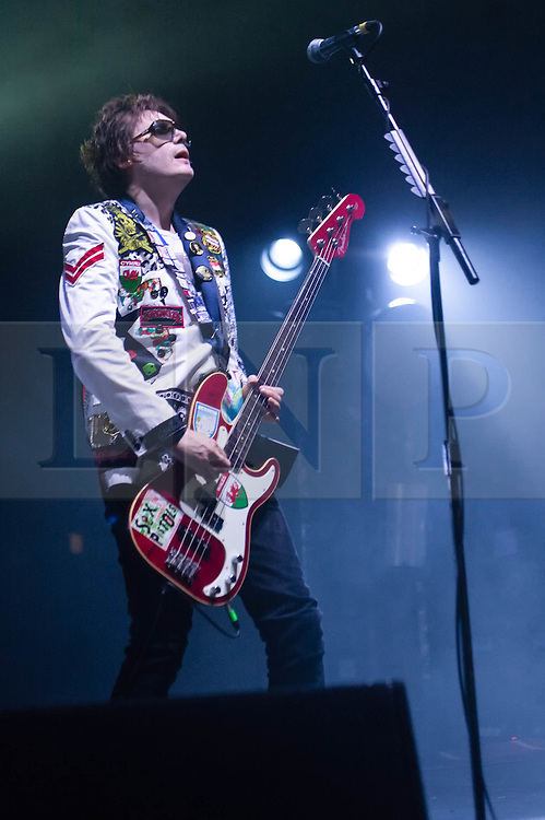 © Licensed to London News Pictures. 11/04/2014. London, UK.   Manic Street Preachers performing live at Brixton Academy. In this picture - Nicky Wire.  Manic Street Preachers are a Welsh alternative rock band consisting of James Dean Bradfield (lead vocals, lead guitar), Nicky Wire (bass guitar, lyrics) and Sean Moore (drums).  Photo credit : Richard Isaac/LNP