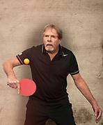 Mature Man Playing Ping Pong.
