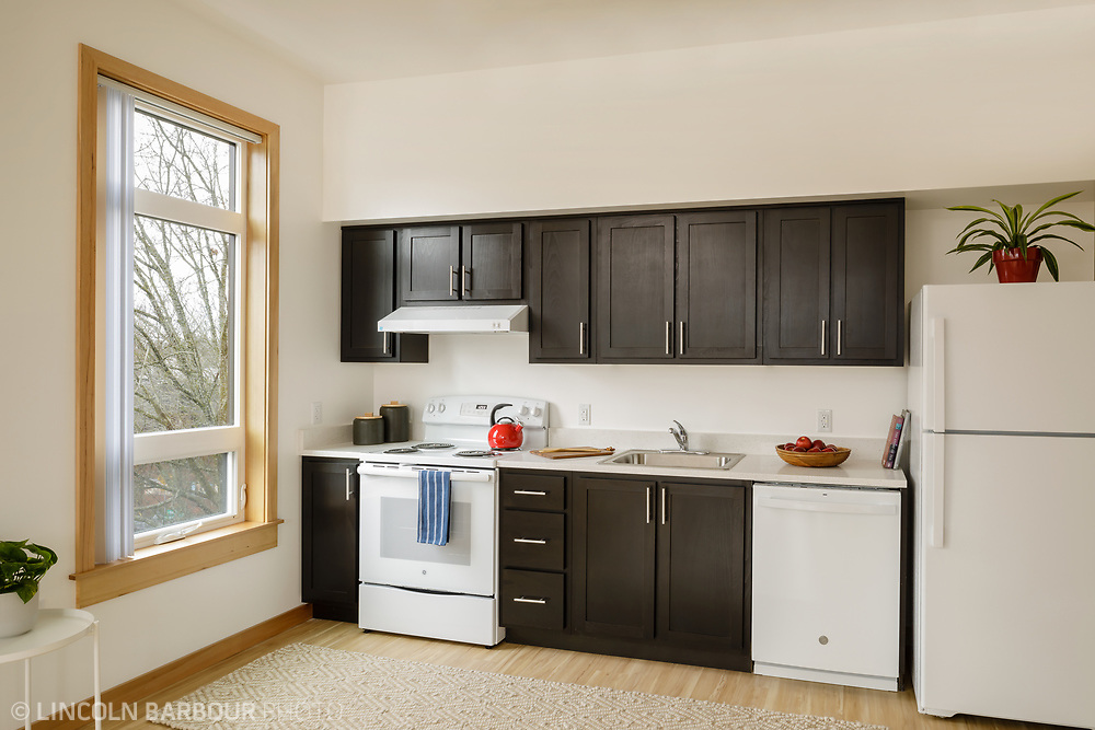 A small kitchen in an affordable housing apartment building.