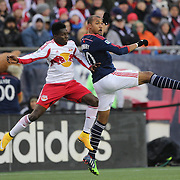 Teal Bunbury, (right), New England Revolution, challenged by Ambroise Oyongo, New York Red Bulls,  during the New England Revolution Vs New York Red Bulls, MLS Eastern Conference Final, second leg. Gillette Stadium, Foxborough, Massachusetts, USA. 29th November 2014. Photo Tim Clayton