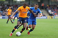 AFC Wimbledon striker Kweshi Appiah (9) battles for possession with Oldham Athletic midfielder Ousmane Fane (24) during the EFL Sky Bet League 1 match between AFC Wimbledon and Oldham Athletic at the Cherry Red Records Stadium, Kingston, England on 21 April 2018. Picture by Matthew Redman.