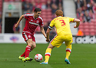 Stewart Downing (Middlesbrough FC) watched by Dean Lewington (Milton Keynes Dons) during the Sky Bet Championship match between Middlesbrough and Milton Keynes Dons at the Riverside Stadium, Middlesbrough, England on 12 September 2015. Photo by George Ledger.
