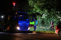 © Licensed to London News Pictures. 16/08/2021. Yarnton, UK. Emergency services on the A40 in Yarnton in Oxfordshire following reports of a body being located in Cresswell Lake. Thames Valley Police with the assistance of Oxfordshire Fire & Rescue Service and Hampshire Constabulary Marine Unit recovered the body of a woman from the water. The death is currently being treated as unexplained. Photo credit: Peter Manning/LNP