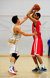 Bristol Academy Flyers' Mostapha Alfaki is closely marked by Essex Leopards' Tom Martin - Photo mandatory by-line: Dougie Allward/JMP - Tel: Mobile: 07966 386802 23/03/2013 - SPORT - Basketball - WISE Basketball Arena - SGS College - Bristol -  Bristol Academy Flyers V Essex Leopards