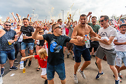 Fans celebrate as Kieran Trippier scores from a free kick to put England into the lead - Ryan Hiscott/JMP - 11/07/2018 - FOOTBALL - Ashton Gate - Bristol, England - England v Croatia, World Cup Village at Ashton Gate, FIFA World Cup Semi Final 2018