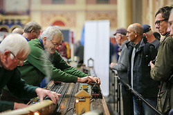 © Licensed to London News Pictures. 17/01/2020. London, UK. A member of Invicta Tracks tends to a model train at the London Model Engineering Exhibition at Alexandra Palace as enthusiasts and hobbyists visit the annual show.  Clubs and societies are exhibiting spectrum of modelling from traditional model engineering, steam locomotives and traction engines through to the more modern gadgets including trucks, boats, aeroplanes and helicopters with nearly 2,000 models constructed by their members. Photo credit: Dinendra Haria/LNP