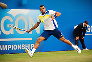 Jo-Wilfried Tsonga of France returns to Britain's Andy Murray, during their semifinal match for the Aegon Championships at the Queen's Club in London, Britain, 15 June 2013. EPA/BOGDAN MARAN