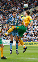 Photo: Richard Lane/Richard Lane Photography. Coventry City v Norwich City. Coca-Cola Championship. 09/08/2008. Coventry's Stephen Wright (lt) and Norwich's John Kennedy challenge for the ball.