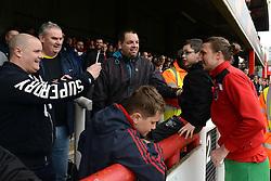 Bristol City fans take photos with Luke Ayling of Bristol City - Mandatory by-line: Dougie Allward/JMP - 16/04/2016 - FOOTBALL - Griffin Park - Brentford, England - Brentford v Bristol City - Sky Bet Championship