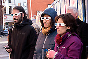 The Seedhead Arts tour group dons 3D glasses to view a wall in the Cathedral District of Belfast November 11, 2018.