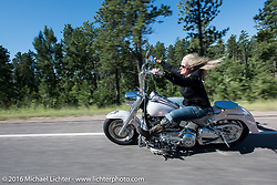 Cat Hammes, the One Legged Blonde on the Harley-Davidson Angels Ride to benefit the Nature Conservancy during the annual Sturgis Black Hills Motorcycle Rally.  SD, USA.  August 12, 2016.  Photography ©2016 Michael Lichter.